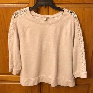 Cream colored sweatshirt with lace sleeve inserts